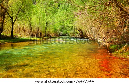 Beautiful peaceful landscape with forest river? and green trees - stock photo