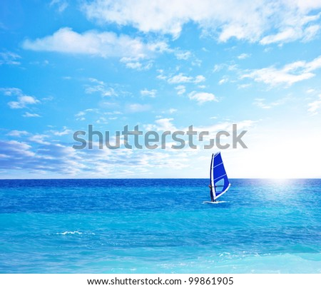 Beautiful peaceful paradise beach, man playing windsurf, scenic blue natural seascape landscape, tropical nature background, summer fun outdoor activities, freedom and travel, active people lifestyle