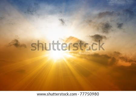Beautiful peaceful sunset - bright sun, yellow beams - stock photo