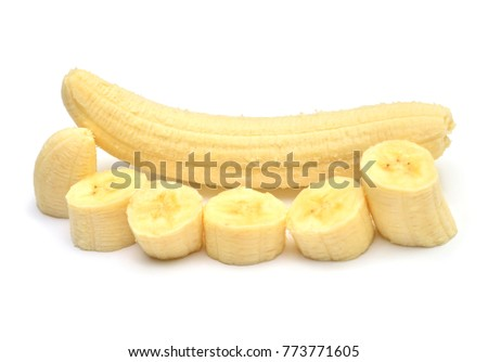 Beautiful peeled banana without peel and rings cut isolated on white background. Pieces, tropical fruit. Cutting