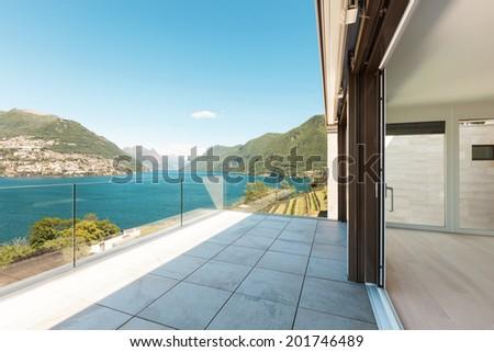 beautiful penthouse with panoramic veranda on the lake  - stock photo