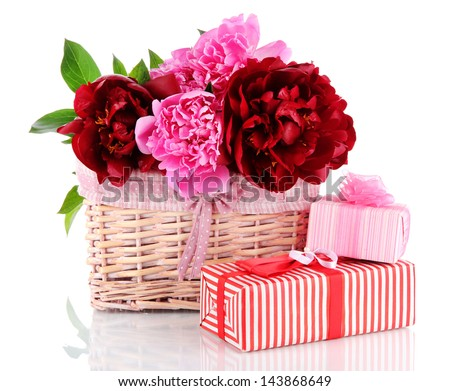 Beautiful peonies in wicker basket isolated on white - stock photo