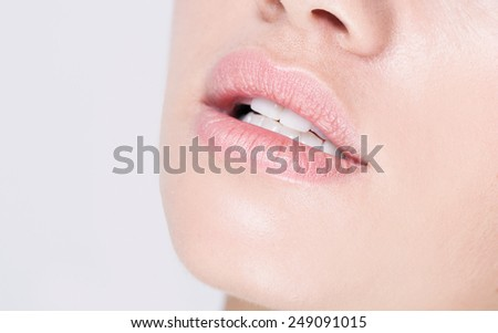 Beautiful Perfect Lips. Sexy Mouth close up. Beauty young woman Lips. Close up over white background, white teeth - stock photo