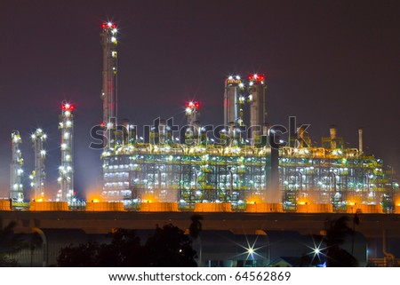 beautiful petrochemical oil refinery plant at night - stock photo