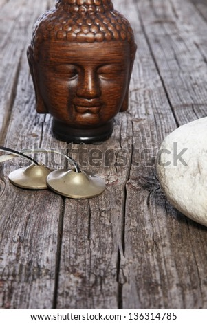 Beautiful photo composite of God Buddha's Head Sculpture placed on some wooden surface. - stock photo