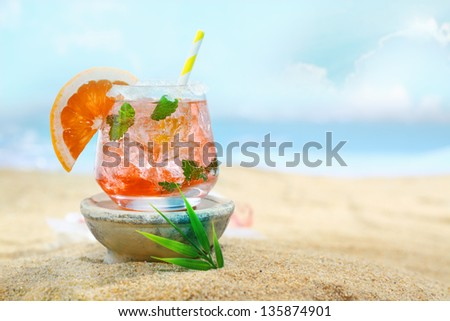 Beautiful photo of delicious looking cocktail on the beach. - stock photo