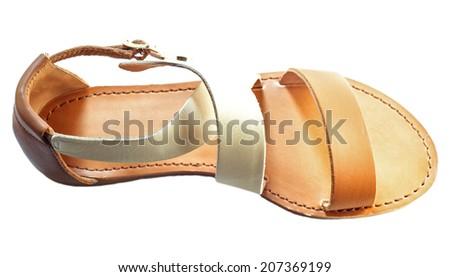 Beautiful photo of female leather sandals isolated on white background. - stock photo