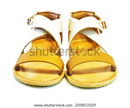 Beautiful photo of female leather sandals isolated on white background.
