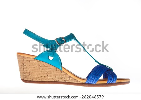 Beautiful photo of female leather sandals isolated on white background. Blue sandals - stock photo