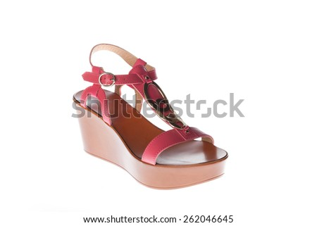 Beautiful photo of female leather sandals isolated on white background. Pink sandals