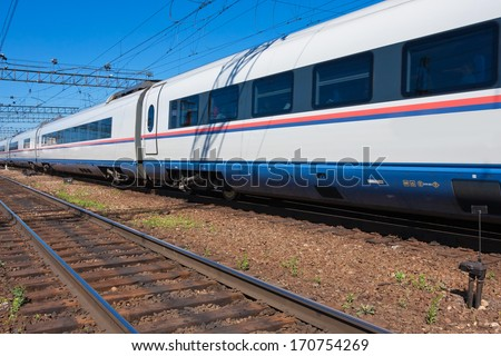 Beautiful photo of high speed modern commuter train - stock photo