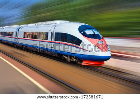 Beautiful photo of high speed modern commuter train, motion blur