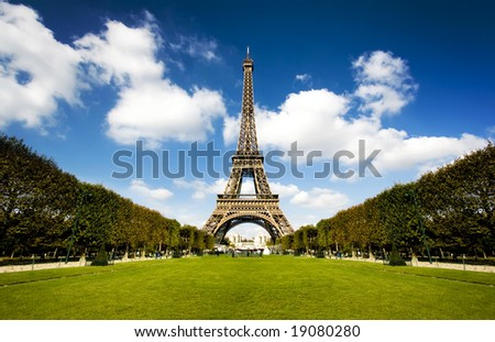 Beautiful photo of the Eiffel tower in Paris with gorgeous colors and wide angle central perspective. - stock photo