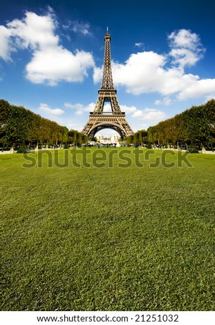 Beautiful photo of the Eiffel tower in Paris with gorgeous colors and wide angle central perspective. Lots of copy space grass. - stock photo