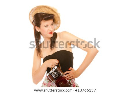 Beautiful photographer. Cute lovely retro style summer teen girl in hat holding using vintage old camera isolated on white background - stock photo