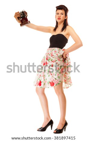Beautiful photographer. Cute lovely retro style summer teen girl taking self-portrait from vintage film camera isolated on white background