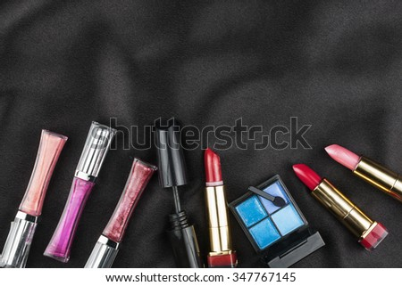 Beautiful picture of cosmetic  on black silk, with space for your text - stock photo
