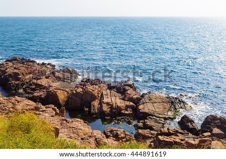 Beautiful picturesque seascape. Black Sea coast in bright sunny day. Rocky coast with large stone and.blue sea water. - stock photo