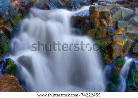 Beautiful picturesque waterfall in high dynamic range. - stock photo