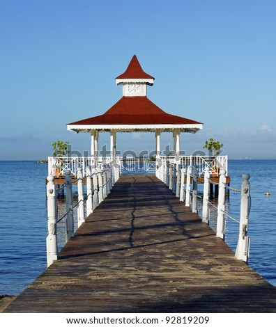 Beautiful pier leads out to Caribbean gazebo for a perfect place to hold your intimate wedding