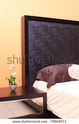 Beautiful pillow with an embroidery on a bed - stock photo