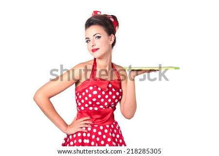 Beautiful pin-up girl holding clean green flat tray or cutting board. Isolated on white background. - stock photo