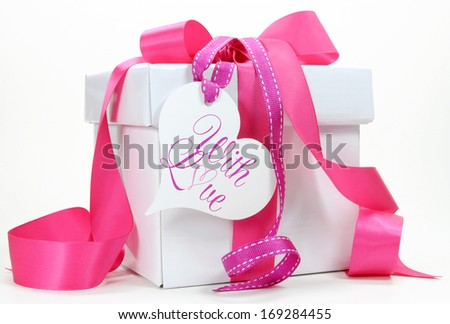 Beautiful pink and white gift box present for Christmas, Valentine, birthday, wedding or mothers day special holiday and occasions. - stock photo