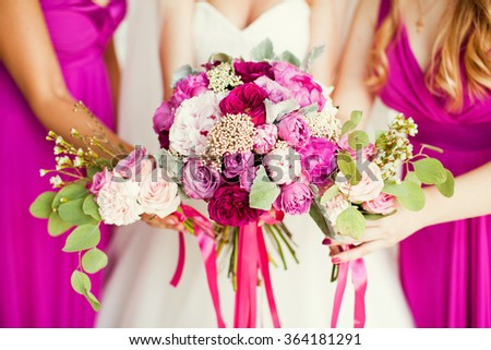 Beautiful pink bouquet in bride's hands