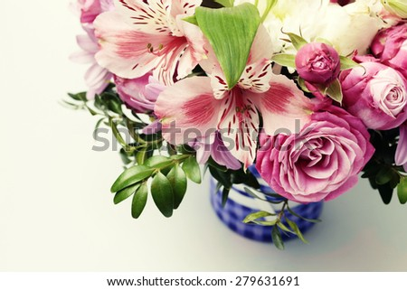 Beautiful pink bouquet with astrantia, fresia, rose, ranunculus. Toned close up image with copy space, selective focus - stock photo