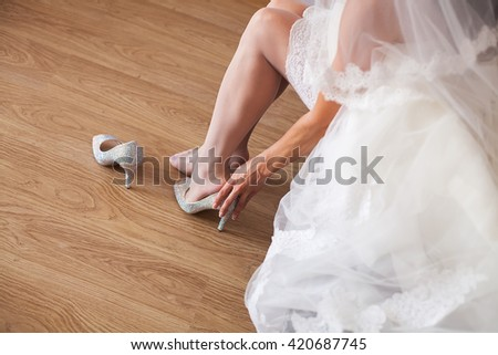 Beautiful pink bride's shoes elegant high heels stylish beige shoes decorated with rhinestones beautiful and elegant shoes of a young girl - stock photo