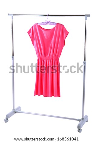 Beautiful pink dress hanging on hangers isolated on white - stock photo