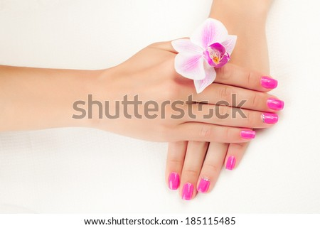 beautiful pink manicure on white