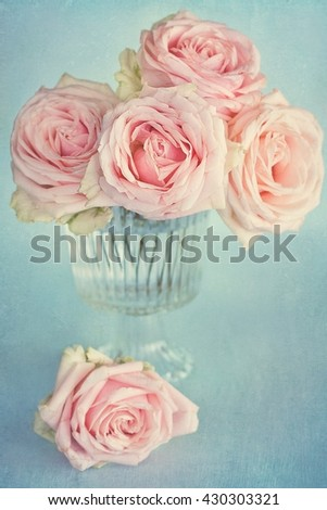 Beautiful pink rose flowers in a vase . Vintage style ,grunge paper background. - stock photo