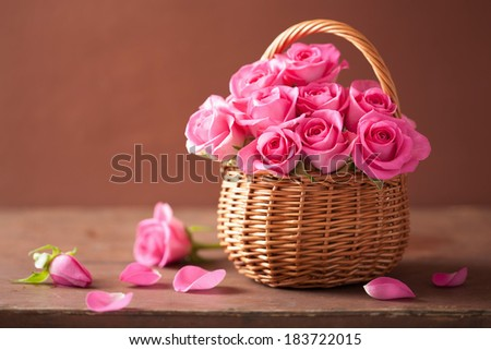 beautiful pink roses in basket  - stock photo