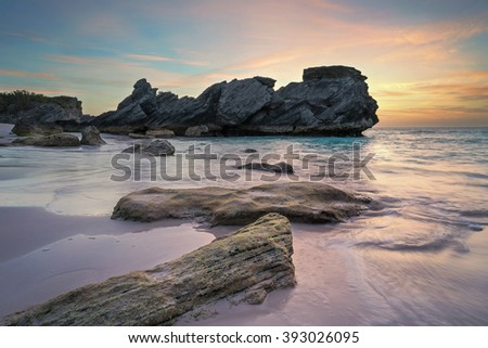 Beautiful pink sand Bermuda beach at sunrise - stock photo