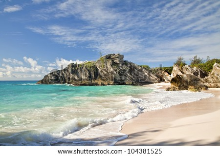 Beautiful pink sand on a secluded beach on the south shore of Bermuda. - stock photo