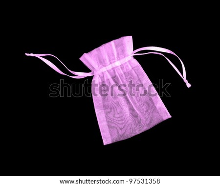 Beautiful pink sheer silk pouch / bag to hold jewelry and delicate items isolated on black background - stock photo