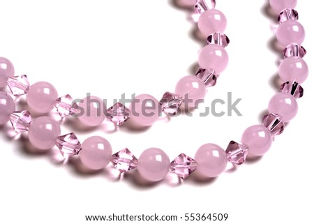 Beautiful pink string of beads isolated on white background - stock photo