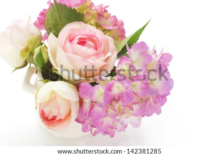 Beautiful pink summer bouquet in vase. Hydrangea and roses