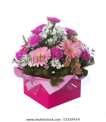 Beautiful pink themed floral arrangement in presentation box isolated over white background. - stock photo