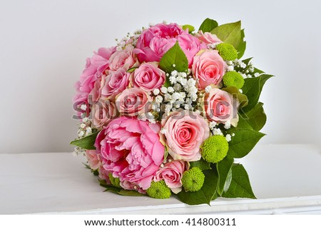 Beautiful pink wedding bouquet on white background