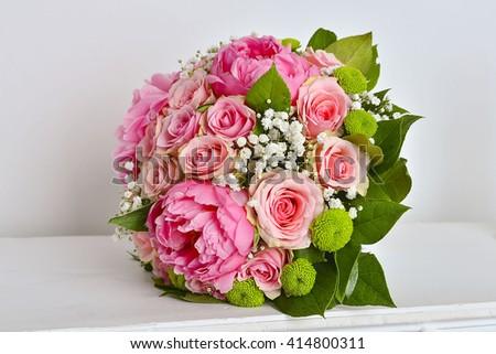 Beautiful pink wedding bouquet on white background - stock photo