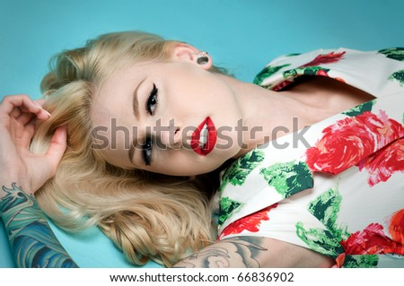 Beautiful pinup girl wearing Christmas dress - stock photo