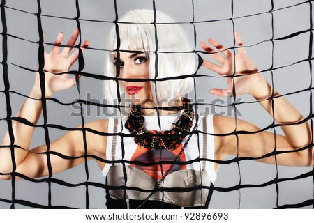 beautiful pinup girl with pearl necklace,  behind a netting