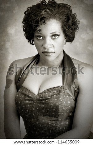 Beautiful pinup model posing for a head shot - stock photo