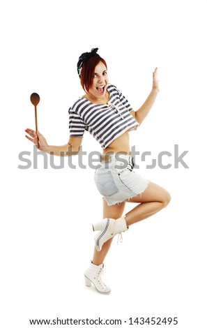 Beautiful pinup style housewife with wooden spoon. Isolated on white background - stock photo