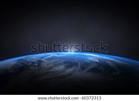 Beautiful planet Earth and the rising Sun - stock photo