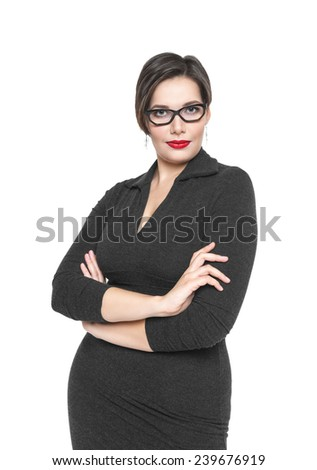 Beautiful plus size woman in black dress and glasses posing  - stock photo