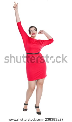 Beautiful plus size woman in red dress posing  - stock photo