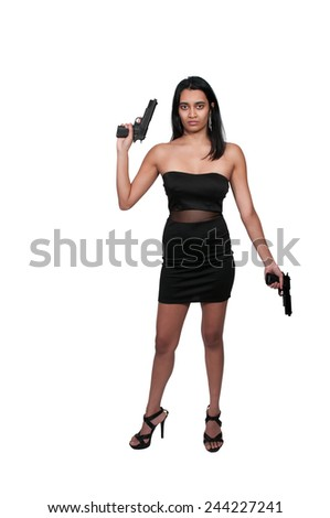 Beautiful police detective woman on the job with a gun - stock photo